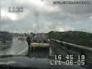 Cop Gets Rocked By Oncoming Traffic
