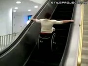idiot in a wheel chair tries going down escalator - FAIL!