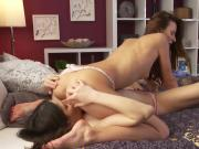 Lesbians having oral sex in bedroom