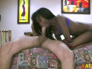 African babe gives head and gets pounded in doggy