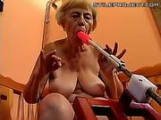 Granny Blowing A Dildo Fucking Machine