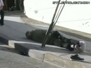 Skateboarder Jump Onto Sloped Sidewalk - Nuts crushed
