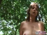 Slutty blonde mature woman rides and sucks her horny lover's dick in a forest