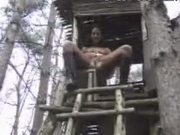 Chick Pisses To Ground From High Up Tree House Shack