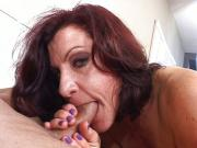 Redhead granny blowing cock for cum