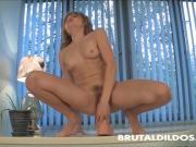 Malika fucks her hairy pussy with a big dildo