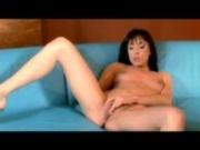 Sexy brunette using her dildo
