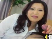 Asian MILF Giving A Footjob