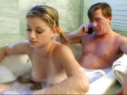 Dad and stepdaughter having fun in bathroom