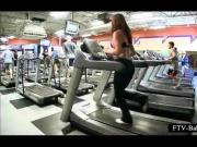 Sexy sporty girl teasing breasts while working out