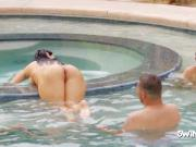 Swinger amateur lady enjoys oral sex next to the swimming pool in front of other couples.