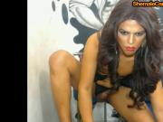 Latin tranny plays with his cock on cam