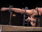 Blonde in extreme device bondage caned