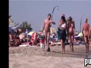 Nudists Walking Around At The Beach