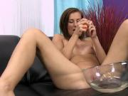 Glamorous chick is pissing and fingering shaved pussy