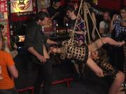 Bound slaves banged in public bar for the crowd