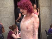 Redhead wrapped in plastic in public