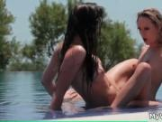 Gorgeous blonde fucking her brunette friend in the pool