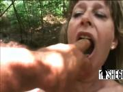 Kinky milf masturbates and bangs in the outdoors