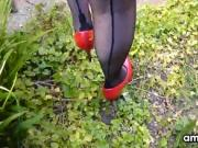 Red High Heels On The Grass