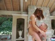 Alaina Dawson down on her knees sucking a big cock