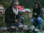 Two brunette hotties enjoying a hot campfire outdoors b