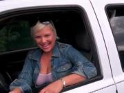 Busty MILF in tight body suit washing a car outdoor