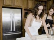 Naked lesbians in aprons making pizzas