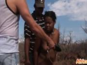 African babe gets abused by two horny studs outdoors