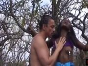 African MILF tied to a tree gives blow job and flogged