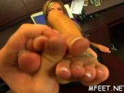 Busty blonde and her footjob skills