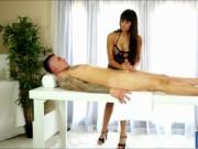Busty masseuse milking her clients cock under the massa