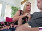 Busty blone MILF whore giving an amazing blowjob to her