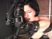 Horny brunette in chains gags herself and gets machine