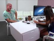 Muscled guy licks female agent on a desk