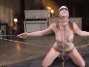 Blindfolded slave in bondage whipped