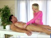 Hot blonde masseuse Miley May blowjobs under the table