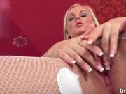 Sexy blonde babe rubs and finger fucks her wet pussy by