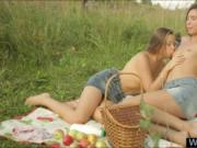 Two lesbians enjoying outdoor picnic and their sweet pu