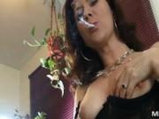 Big tits dirty brown haired whore undressing while smok