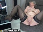 Sexy granny in black stockings loves pleasing her own p