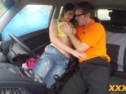 Busty teen slurping cock in car
