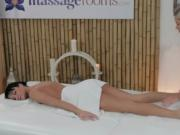 Blonde masseuse rubbing and oiling pussy