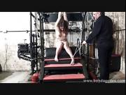 Kinky Beauvoir enslaved and tied up in dungeon bondage and leather outfitted submissive restrained in bdsm furniture