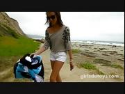 Young petite brunette runs naked at beach and masturbates