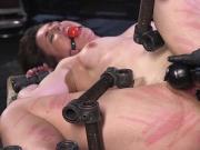 Brunette in metal device bondage caned