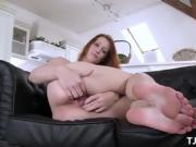 Redhead Sonja fingers her wet cunt