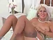 Horny blonde fucks big dildo toy in vintage nylons suspenders