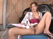 Traditionally dressed Japanese redhead toys her pussy
