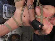 Shaved pussy blonde tormented in bondage